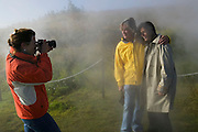Annie Griffiths-Belt photographing Keith and Melina Bellows at the Deildartunguhver Hot Spring (Europe and Iceland's largest hot spring) near Akranes, Iceland.