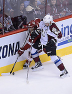 Apr. 6, 2013; Glendale, AZ, USA;  Phoenix Coyotes center Antoine Vermette (50) handles the puck in the  first period against the Colorado Avalanche left wing Gabriel Landeskog (92) at Jobing.com Arena. Mandatory Credit: Jennifer Stewart-USA TODAY Sports
