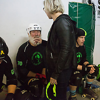 "Dick ""Merby Dick"" Roche joins his teammates on the Lane County Concussion in a bout against Uinta Madness during the Testosterdome mens roller derby tournament, in Salt Lake City, Utah, on Saturday, November 8, 2014. Roche is 74, could be the oldest man competing in derby."