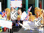 Spectators with personal messages for the athletes during the Manchester Olympic Parade in Manchester, United Kingdom on 17 October 2016. Photo by Richard Holmes.