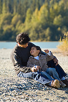 Dad and son laugh with each other at Green Lake, Whistler, BC