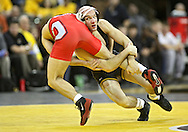January 22 2010: Iowa's Matt Ballweg takes down Ohio State's Mike Fee during the 149-pound bout an NCAA wrestling dual at Carver-Hawkeye Arena in Iowa City, Iowa on January 22, 2010. Ballweg defeated Fee in a major decision 12-3 and Iowa defeated Ohio State 33-3..