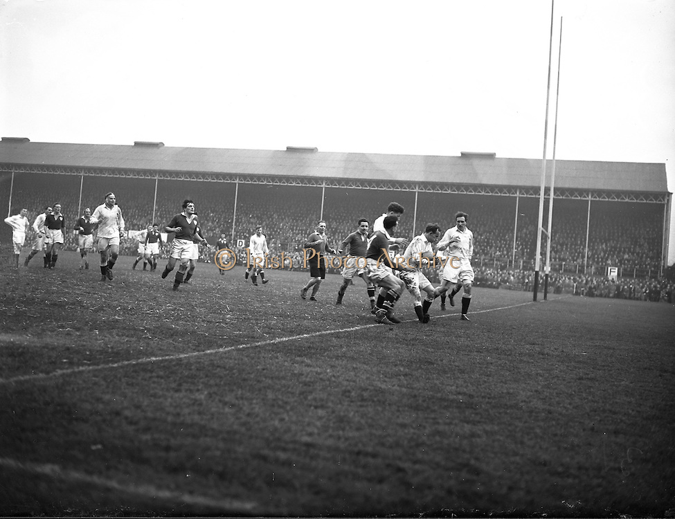 Irish Rugby Football Union, Ireland v England, Five Nations, Landsdowne Road, Dublin, Ireland, Saturday 14th February, 1953,.14.2.1953, 2.14.1953,..Referee- MR A W C Austin, Scottish Rugby Union, ..Score- Ireland 9 - 9 England, ..Irish Team,..R J Gregg, Wearing number 15 Irish jersey, Full Back, Queens University Rugby Football Club, Belfast, Northern Ireland,..M F Lane,  Wearing number 14 Irish jersey, Right wing, University college Cork Football Club, Cork, Ireland,  ..N J Henderson, Wearing number 13 Irish jersey, Right centre, N.I.F.C, Rugby Football Club, Belfast, Northern Ireland,..K Quinn, Wearing number 12 Irish jersey, Left Centre, Old Belvedere Rugby Football Club, Dublin, Ireland,  ..M Mortell, Wearing number 11 Irish jersey, Left wing, Bective Rangers Rugby Football Club, Dublin, Ireland,. . J W Kyle, Wearing number 10 Irish jersey, Stand Off, Captain of the Irish team, N.I.F.C, Rugby Football Club, Belfast, Northern Ireland,..J A O'Meara, Wearing number 9 Irish jersey, Scrum, University college Cork Football Club, Cork, Ireland,  ..W A O'Neill, Wearing number 1 Irish jersey, Forward, University College Dublin Rugby Football Club, Dublin, Ireland, ..R Roe, Wearing number 2 Irish jersey, Forward, Dublin University Rugby Football Club, Dublin, Ireland,..F E Anderson, Wearing number 3 Irish jersey, Forward, Queens University Rugby Football Club, Belfast, Northern Ireland,..T E Reid, Wearing number 4 Irish jersey, Forward, Garryowen Rugby Football Club, Limerick, Ireland, ..J R Brady, Wearing number 5 Irish jersey, Forward, C I Y M S Rugby Football Club, Belfast, Northern Ireland, .  .J S McCarthy, Wearing number 6 Irish jersey, Forward, Dolphin Rugby Football Club, Cork, Ireland, ..R Kavanagh, Wearing number 7 Irish jersey, Forward, University College Dublin Rugby Football Club, Dublin, Ireland,..W E Bell, Wearing number 8 Irish jersey, Forward, Collegians Rugby Football Club, Belfast, Northern Ireland,.  .Engish Team,..N M Hall, Wearing number 1 Engish jer
