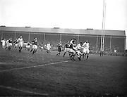 Irish Rugby Football Union, Ireland v England, Five Nations, Landsdowne Road, Dublin, Ireland, Saturday 14th February, 1953,.14.2.1953, 2.14.1953,..Referee- MR A W C Austin, Scottish Rugby Union, ..Score- Ireland 9 - 9 England, ..Irish Team,..R J Gregg, Wearing number 15 Irish jersey, Full Back, Queens University Rugby Football Club, Belfast, Northern Ireland,..M F Lane,  Wearing number 14 Irish jersey, Right wing, University college Cork Football Club, Cork, Ireland,  ..N J Henderson, Wearing number 13 Irish jersey, Right centre, N.I.F.C, Rugby Football Club, Belfast, Northern Ireland,..K Quinn, Wearing number 12 Irish jersey, Left Centre, Old Belvedere Rugby Football Club, Dublin, Ireland,  ..M Mortell, Wearing number 11 Irish jersey, Left wing, Bective Rangers Rugby Football Club, Dublin, Ireland,. . J W Kyle, Wearing number 10 Irish jersey, Stand Off, Captain of the Irish team, N.I.F.C, Rugby Football Club, Belfast, Northern Ireland,..J A O'Meara, Wearing number 9 Irish jersey, Scrum, University college Cork Football Club, Cork, Ireland,  ..W A O'Neill, Wearing number 1 Irish jersey, Forward, University College Dublin Rugby Football Club, Dublin, Ireland, ..R Roe, Wearing number 2 Irish jersey, Forward, Dublin University Rugby Football Club, Dublin, Ireland,..F E Anderson, Wearing number 3 Irish jersey, Forward, Queens University Rugby Football Club, Belfast, Northern Ireland,..T E Reid, Wearing number 4 Irish jersey, Forward, Garryowen Rugby Football Club, Limerick, Ireland, ..J R Brady, Wearing number 5 Irish jersey, Forward, C I Y M S Rugby Football Club, Belfast, Northern Ireland, .  .J S McCarthy, Wearing number 6 Irish jersey, Forward, Dolphin Rugby Football Club, Cork, Ireland, ..R Kavanagh, Wearing number 7 Irish jersey, Forward, University College Dublin Rugby Football Club, Dublin, Ireland,..W E Bell, Wearing number 8 Irish jersey, Forward, Collegians Rugby Football Club, Belfast, Northern Ireland,.  .Engish Team,..N M Hall, Wearing number 1 Engish jer