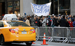 © Licensed to London News Pictures. 10/11/2016. New York CIty, USA. Demonstrators opposite the entrance to Trump Tower, the home of president-elect Donald Trump. Protests have taken place outside Trump tower following a shock election victory by the controversial republican candidate earlier this week. Photo credit: Tolga Akmen/LNP