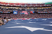 A large American flag is displayed on the field during the playing of the National Anthem before the Washington Redskins 2016 NFL week 1 regular season football game against the Pittsburgh Steelers on Monday, Sept. 12, 2016 in Landover, Md. The Steelers won the game 38-16. (©Paul Anthony Spinelli)