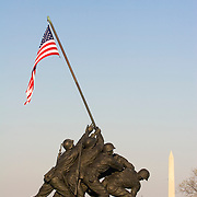 Iwo Jima Statue US Marine Corps Memorial Bronze sculpture by Felix DeWeldon near Arlington National Cemetary Arlington Virginia with the Washington Monument and the US Capitol Building in the background<br />