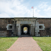 "SULLIVAN'S ISLAND, South Carolina - The entrance to Fort Moultrie is the former Sally-Port, which was designed to allow troops to gather for an attack, or ""Sally,"" on a beseiging enemy. After the original Sally-port was destroyed during the Civil War, this one was built in the 1870s. Fort Moultrie is part of the Fort Sumter National Monument at the entrance to Charleston Harbor in South Carolina. The fort has played a crucial role in defending the harbor from the time of the Revolutionary War through World War II. During that time it has undergone multiple upgrades, from the original palmetto log walls to the newer heavily fortified earthen bunkers."