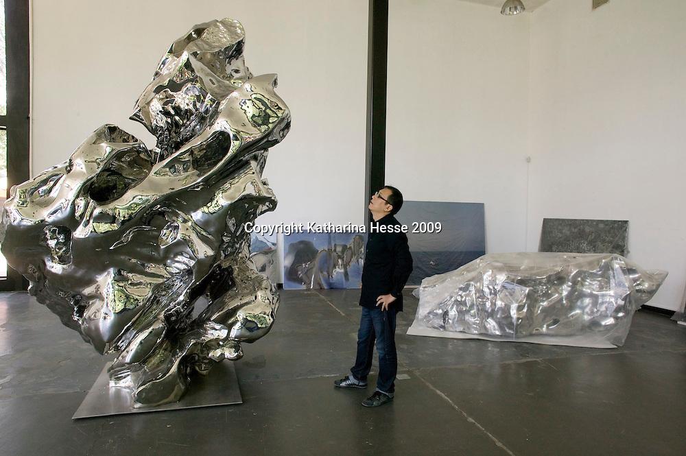 BEIJING, SEPTEMBER-9 : ARTIST ZHAN WANG IN HIS STUDIO ON THE OUTSKIRTS OF BEIJING.