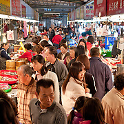 Crowded aisle at Zhiyou Evening Market, Kaohsiung City, Taiwan