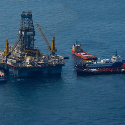 Transocean's Development Driller III leased by BP Plc works to drill a relief well at the source of the BP Plc Deep Water Horizon oil spill site in the Gulf of Mexico off the coast of Louisiana, U.S., on Sunday, July 11, 2010. Oil is once again gushing freely into the Gulf of Mexico as BP Plc is in the process of changing out the cap from the leaking well and plans to have a new cap installed over the next few days that will allow for oil to be captured efficiently. Photographer: Derick E. Hingle/Bloomberg