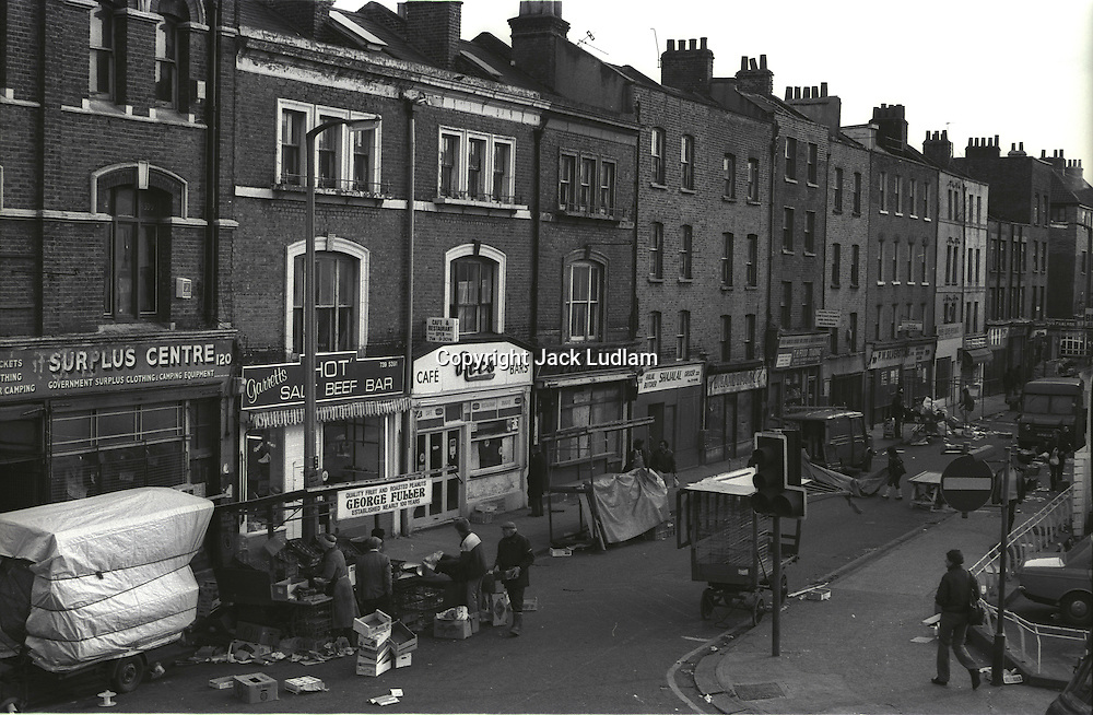 View of brick lane marketfinishing up for the day.<br /> From Series of 7 Limited Edition (30) Large Framed Prints A3 Shot on film neg Black and White pictures Depicting Brick Lane Market London,  2 feb 1984 Photographer  Jack Ludlam<br /> £1,200