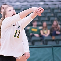 1st year setter Kirstin Greve (17) of the Regina Cougars during the home game on January 6 at Centre for Kinesiology, Health and Sport. Credit: Arthur Ward/Arthur Images