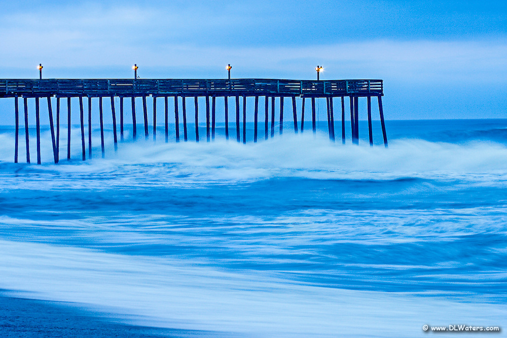 A long exposure of waves pounding Kitty Hawk Fishing Pier.