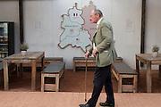 Un uomo cammini davanti ad una cartina della divisione di Berlino. Berlino, Germania, 14 ottobre 2014. Guido Montani / OneShot<br /> <br /> A man walking in front of a map showing the city of Berlin divided in east and west. Berlin, Germany, 14 ottobre 2014. Guido Montani / OneShot