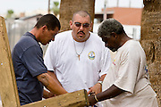 07 AUGUST 2005 - PHOENIX, AZ: DUANE, left, and MIKE, center, both from the Church of the Street shelter in central Phoenix, pray with a street person in downtown Phoenix Sunday. Members of the Church of the Street walk through downtown Phoenix praying with the homeless.  PHOTO BY JACK KURTZ