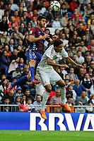 Real Madrid´s Raphael Varane and Eibar´s Raul Rodriguez Navas during 2014-15 La Liga match between Real Madrid and Eibar at Santiago Bernabeu stadium in Madrid, Spain. April 11, 2015. (ALTERPHOTOS/Luis Fernandez)