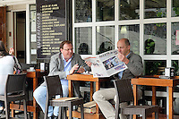 Cafe life, men, locals, checking, mobile phone, reading, newspaper, Santander, Spain, May, 2015, 201505080897<br />