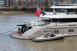 © Licensed to London News Pictures. 01/10/2016. LONDON, UK.  Staff working next to the dinghy attached to superyacht Kismet. Kismet' arrived in London and moored at Butlers Wharf on the River Thames earlier this week, but the silver Jaguar was not fitted on its arrival. Kismet is 308 feet long and is reportedly owned by Pakistani-American billionaire Shahid Khan. Mr Khan owns the National Football League (NFL) team, the Jacksonville Jaguars, who are due to play the Colts in an International Series game at Wembley tomorrow. Kismet has 6 staterooms, with the master bedroom having its own private deck with jacuzzi and helipad and can be chartered for an estimated £1m per week.  Photo credit: Vickie Flores/LNP