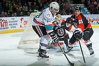 KELOWNA, CANADA - JANUARY 23: Nick Merkley #10 of Kelowna Rockets is stick checked by Chad Butcher #21 in front of the net of Nick Schneider #31 of Medicine Hat Tigers on January 23, 2016 at Prospera Place in Kelowna, British Columbia, Canada.  (Photo by Marissa Baecker/Shoot the Breeze)  *** Local Caption *** Nick Merkley; Nick Schneider; Chad Butcher;