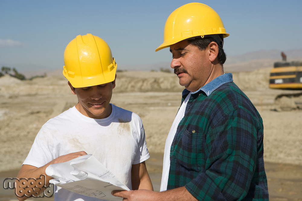Construction Workers reading blueprint