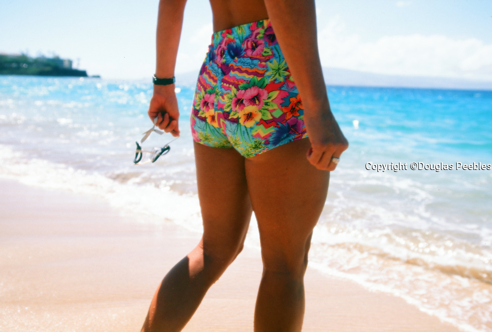 Woman walking into water, Kaanapali Beach, Maui, Hawaii