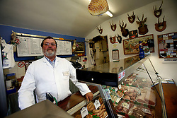 UK ENGLAND BERKSHIRE CHAPEL ROW 22MAR11 - Butcher Martin Fidler (60) poses for a portait at his butchers' shop in Chapel Row, Berkshire, England. Mr Fidler and his wife are long-standing friends of the Middleton family and have received an invite to the Royal Wedding on the 29th of April 2011...jre/Photo by Jiri Rezac..© Jiri Rezac 2011