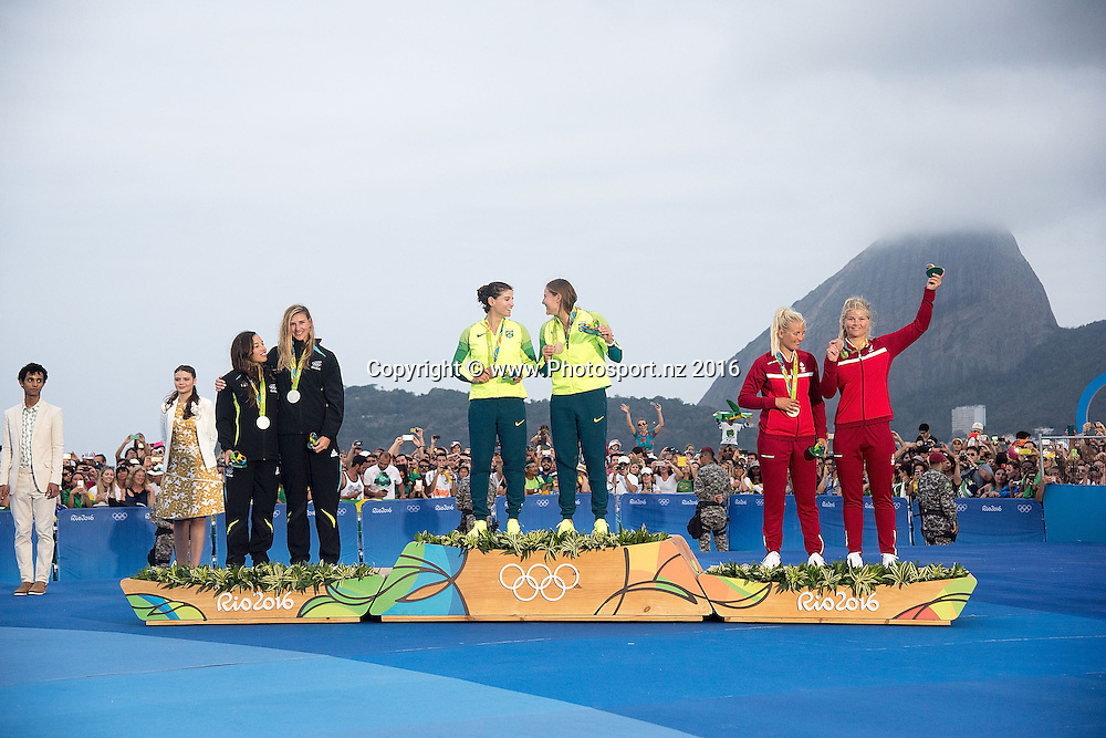 New Zealand's Alexandra Maloney<br /> and Molly Meech Silver, Brazil&rsquo;s Martine Grael and Kahena Kunze Gold and Denmark's Jena Hansen and  Katja Salskov-Iversen Bronze during the Women's 49fx class sailing race medal ceremony at the 2016 Rio Olympics on Thursday the 18th of August 2016. &copy; Copyright Photo by Marty Melville / www.Photosport.nz