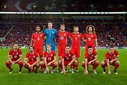 CARDIFF, WALES - Thursday, September 6, 2018: Wales players line-up for a team group photograph before the UEFA Nations League Group Stage League B Group 4 match between Wales and Republic of Ireland at the Cardiff City Stadium. Back row L-R: captain Ashley Williams, goalkeeper Wayne Hennessey, Chris Mepham, Ben Davies, Ethan Ampadu. Front row L-R: Aaron Ramsey, Joe Allen, David Brooks, Connor Roberts, Tom Lawrence, Gareth Bale. (Pic by David Rawcliffe/Propaganda)