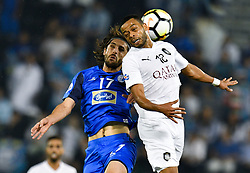Hamid Ismaeil (R) of Al Sadd  heads the ball while being challenged by Humam Tareq of Esteghlal FC during the AFC Asian Champions League quarter-final second legs football match between Qatar's Al Sadd and Iran's Esteghlal FC at Jassim Bin Hamad Stadium Doha, Capital of Qatar, september 17, 2018.Al Sadd qualifying the semi-finals after a 2-2 draw in the second leg of their quarter-final clash with Esteghlal FC gave them a 5-3 aggregate win  (Credit Image: © Nikku/Xinhua via ZUMA Wire)