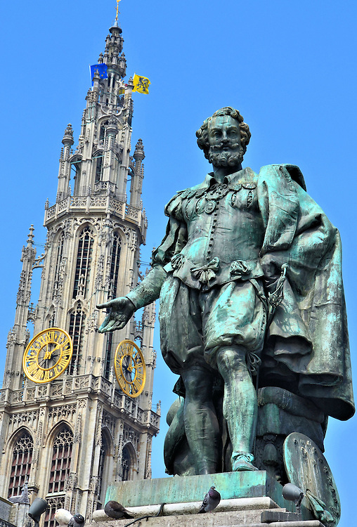 Painter Peter Paul Rubens Statue in Antwerp, Belgium <br /> It is fitting that this statue of Sir Peter Paul Rubens shows the Cathedral of Our Lady in the background because he created some of the altar&rsquo;s most famous baroque paintings in the early 17th century.  Four of his masterpieces still adorn the church.  This statue in the center of Groen Plaats square was created by sculptor William Geefs in 1840.