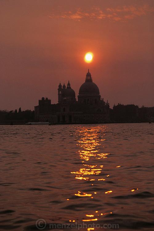 Santa Maria della Salute, with setting sun. Venice, Italy.