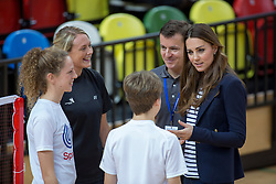 LONDON- UK - 18-OCT-2013: Kate, The Duchess of Cambridge, Patron of SportsAid, will attend a SportsAid Athlete Workshop at the Copper Box, in the Queen Elizabeth Olympic Park, London. Kate viewed young athletes taking part in a number of sports activities, including wheelchair basketball, CP football, volleyball, fencing and badminton. The Duchess then joined athletes and their parents as they attend educational workshops about media and social media training, nutrition in sport and general guidance from Olympians and Paralympians
