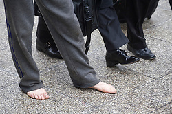 © Licensed to London News Pictures. 27/10/2011. London, UK. The bare feet of an Occupy London demonstrator beside the shoes of an office worker outside St Paul's Cathedral, London today (27/10/2011).  Photo credit: Ben Cawthra/LNP