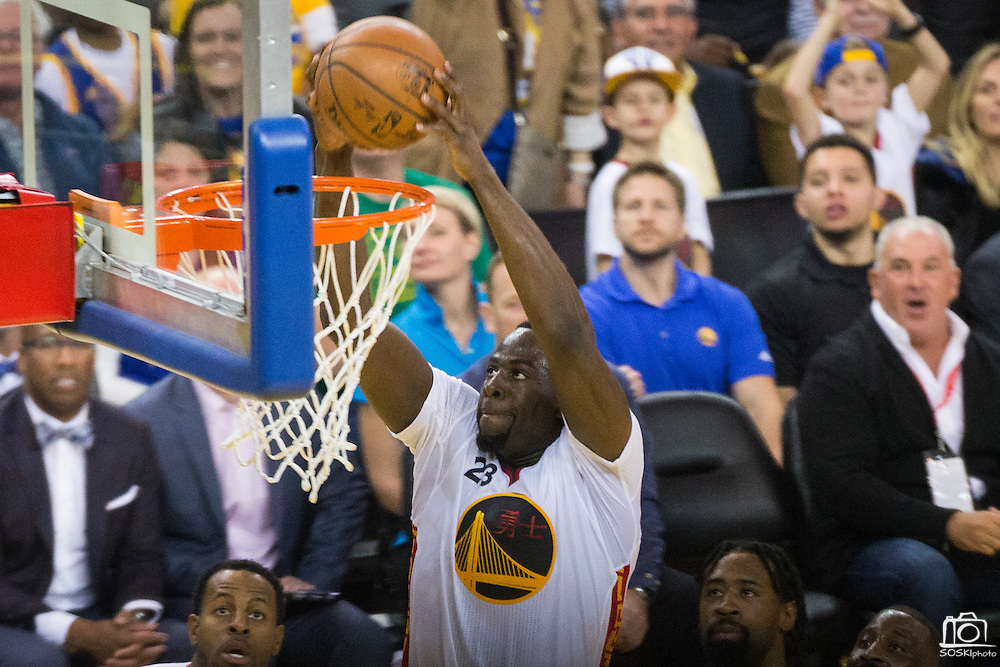 Golden State Warriors forward Draymond Green (23) dunks the ball against the LA Clippers at Oracle Arena in Oakland, Calif., on January 28, 2017. (Stan Olszewski/Special to S.F. Examiner)