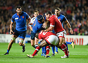 France back row Bernard Le Roux is tackled by Canada hooker Aaron Carpenter; during the Rugby World Cup 2015 Pool D match (22) between France and Canada at Stadium MK, Milton Keynes, England on 1 October 2015. Photo by David Charbit.