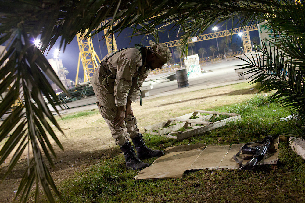 22 august 2011. A rebel pray in Green Square during the night after the rebels enter in Tripoli.