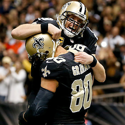 Dec 29, 2013; New Orleans, LA, USA; New Orleans Saints quarterback Drew Brees (9) celebrates with teammate tight end Jimmy Graham (80) following a touchdown during the fourth quarter of a game against the Tampa Bay Buccaneers at the Mercedes-Benz Superdome.The Saints defeated the Buccaneers 42-17. Mandatory Credit: Derick E. Hingle-USA TODAY Sports