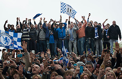© licensed to London News Pictures. London, UK 20/05/2012. Chelsea fans line the streets as members of the Chelsea football team parade through the streets of west London today (20/05/12). Photo credit: Tolga Akmen/LNP