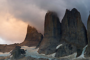 Evening clouds roll in over the Paine Towers in Chilean Patagonia.