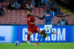 NAPLES, ITALY - Wednesday, October 3, 2018: Liverpool's Mohamed Salah (L) and Napoli's Kalidou Koulibaly during the UEFA Champions League Group C match between S.S.C. Napoli and Liverpool FC at Stadio San Paolo. (Pic by David Rawcliffe/Propaganda)