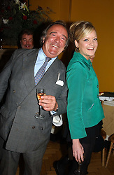 SIR DAI LLEWELLYN and LADY ELOISE ANSON at a private view of jewellery designed and made by Luis Miguel Howard held at 30 Pavillion Road, London on 27th October 2004.<br />
