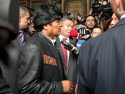 BRUSSELS, BELGIUM - MAY-16-2006 - Karel De Gucht, Belgian Minister of Foreign Affairs, takes one on the chin as reporters fight to get a sound-bite from visiting dignitary Evo Morales, President of Bolivia. Morales held talks with top Belgian government officials Tuesday on his energy nationalization plans. Morales had addressed lawmakers at the European Parliament in Strasbourg, France, on Monday, telling them he would not prevent European energy companies from investing in Bolivia. Earlier this month, he had announced plans to nationalize his South American country's natural gas and oil sector, causing widespread concern that was voiced during last week's EU-Latin America summit...EU leaders urged him not to adopt protectionist economic policies, which they said could be detrimental in fighting poverty and act as a deterrent to foreign investors. Bolivia has the second-largest natural gas reserves in South America, after Venezuela, reports the AP.(PHOTO © JOCK FISTICK)