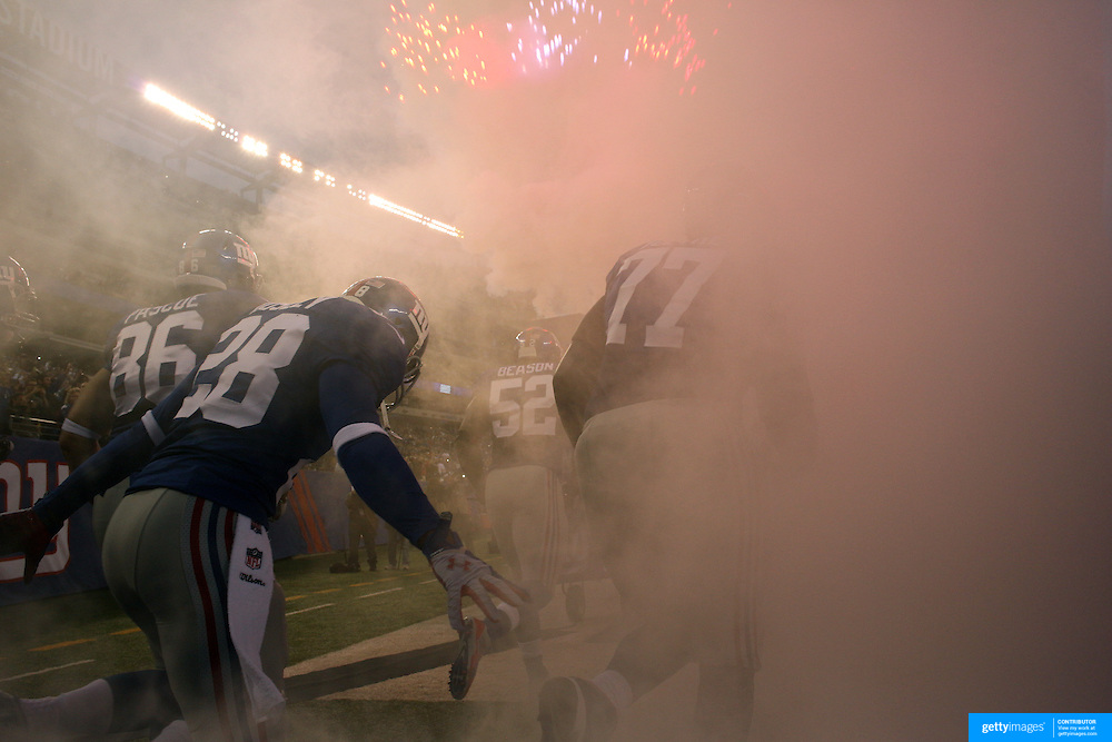New York Giants players take the field through  the smoke effect during the New York Giants Vs Green Bay Packers, NFL American Football match at MetLife Stadium, East Rutherford, New Jersey, USA. 17th November 2013. Photo Tim Clayton