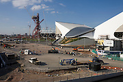 Landscape of 2012 Olympic construction site showing Aquatic centre, The Orbit art tower and the main stadium at Stratford.