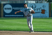 KELOWNA, BC - JULY 24: Nick Dicarlo #16 of the Yakima Valley Pippens throws the ball in the infield against the the Kelowna Falcons at Elks Stadium on July 24, 2019 in Kelowna, Canada. (Photo by Marissa Baecker/Shoot the Breeze)