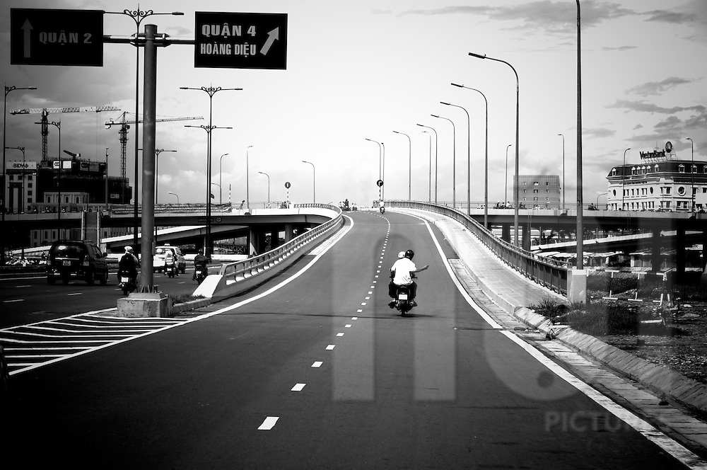 A single motorbike on on a highway junction in Ho Chi Minh City. Vietnam, Asia