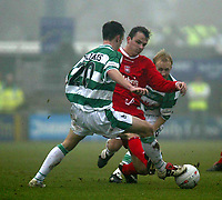 Photo. Andrew Unwin<br /> Yeovil v Liverpool, FA Cup Third Round, Huish Park, Yeovil 04/01/2004.<br /> Liverpool's Dietmar Hamann (c) is tackled by Yeovil players, Gavin Williams (l) and Darren Way (r).