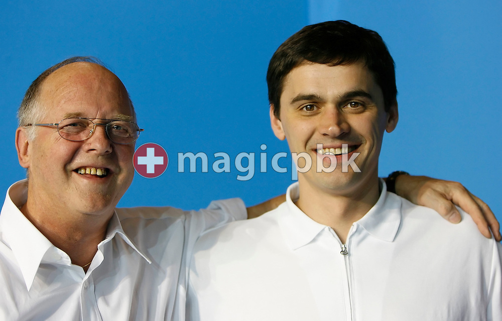 (R-L) Omega ambassador Alexander Popov of Russia and Swiss Timing director Peter Huerzeler of Switzerland are pictured during the Omega Trophy for Journalists in the Susie O'Neill pool at the FINA Swimming World Championships in Melbourne, Australia, Monday 26 March 2007. (Photo by Patrick B. Kraemer / MAGICPBK for Omega)