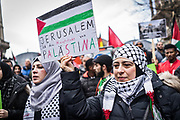 Frankfurt am Main | 16.12.2017<br /> <br /> On Saturday, December 16, 2017 about 1000 men, women and children take part in a demonstration march against the declaration of U.S. president Donald Trump to recognize Jerusalem as the capital of Israel and to relocate the U.S. Embassy in Israel from Tel Aviv to Jerusalem. The demonstration was registered under the slogan &quot;Demo f&uuml;r Jerusalem - Jerusalem/Alkudus ist die Hauptstadt Pal&auml;stinas&quot; (Demo for Jerusalem - Alkudus is the capital of Palestine).<br /> Here: Woman in Kufiya with a small placard which reads &quot;Jerusalem is the capital of Palestine&quot;.<br /> <br /> photo &copy; peter-juelich.com<br /> <br /> - Foto honorarpflichtig<br /> - No Model Release<br /> - No Property Release